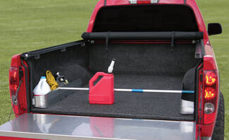 Easy Retriever pole mounted in truck storage pockets