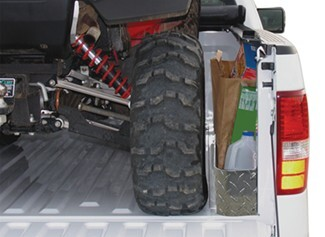 Truck storage pockets with ATV loaded in truck bed