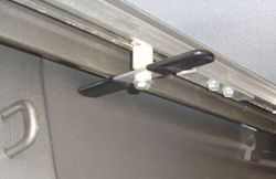 Close-up of twist-latch securing tonneau for travel