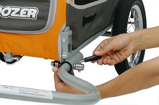 Securing bike hitch arm using quick-release pin and locking nut
