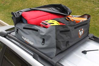 Loaded PackRight Sport 1 cargo bag unzipped and on top of vehicle