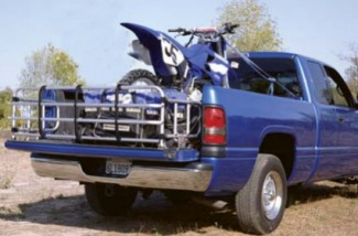 Fold down truck bed extender