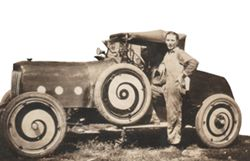 Henry Bross with the first car he built