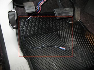 The tow package wires have been connected to the brake controller adapter (20127) wires and have been bound with electrical tape.