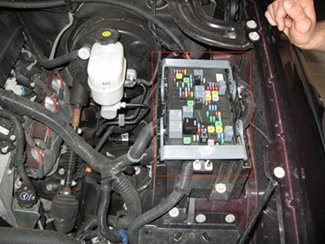 the power distribution box is located on the driver side under the hood   here the