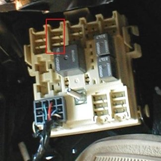 how to install a brake controller on chevrolet gmc 1999 2006 this close up of the electrical junction box the lid off shows several available slots the brake control adapter is plugged into the second slot from