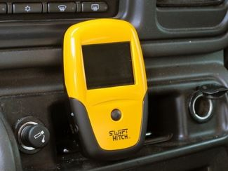 The Swift Hitch SH01 monitor mounted to a dash
