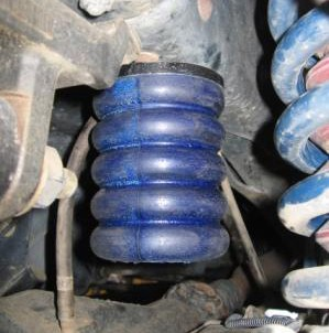 SumoSprings diagram of installation above existing Dodge Ram Pickup spring