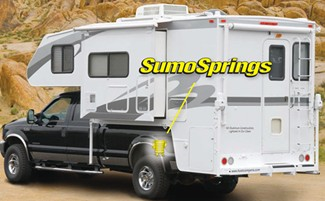 SumoSprings installed on truck with slide-in camper