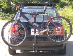 Single arm bike rack installed with bike mounted