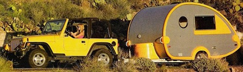 Jeep Wrangler Towing A Teardrop Style Camper