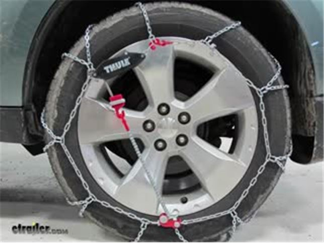 thule self tensioning low profile snow tire chains diamond pattern d link cg9 size 103. Black Bedroom Furniture Sets. Home Design Ideas