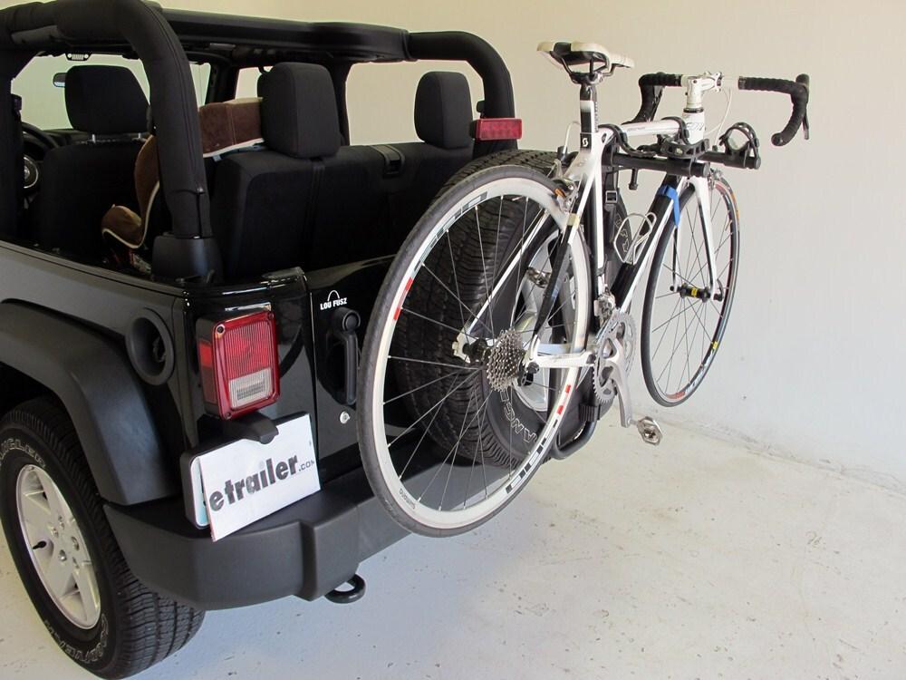 jeep yj hollywood racks sr2 2 bike carrier spare tire mount. Black Bedroom Furniture Sets. Home Design Ideas