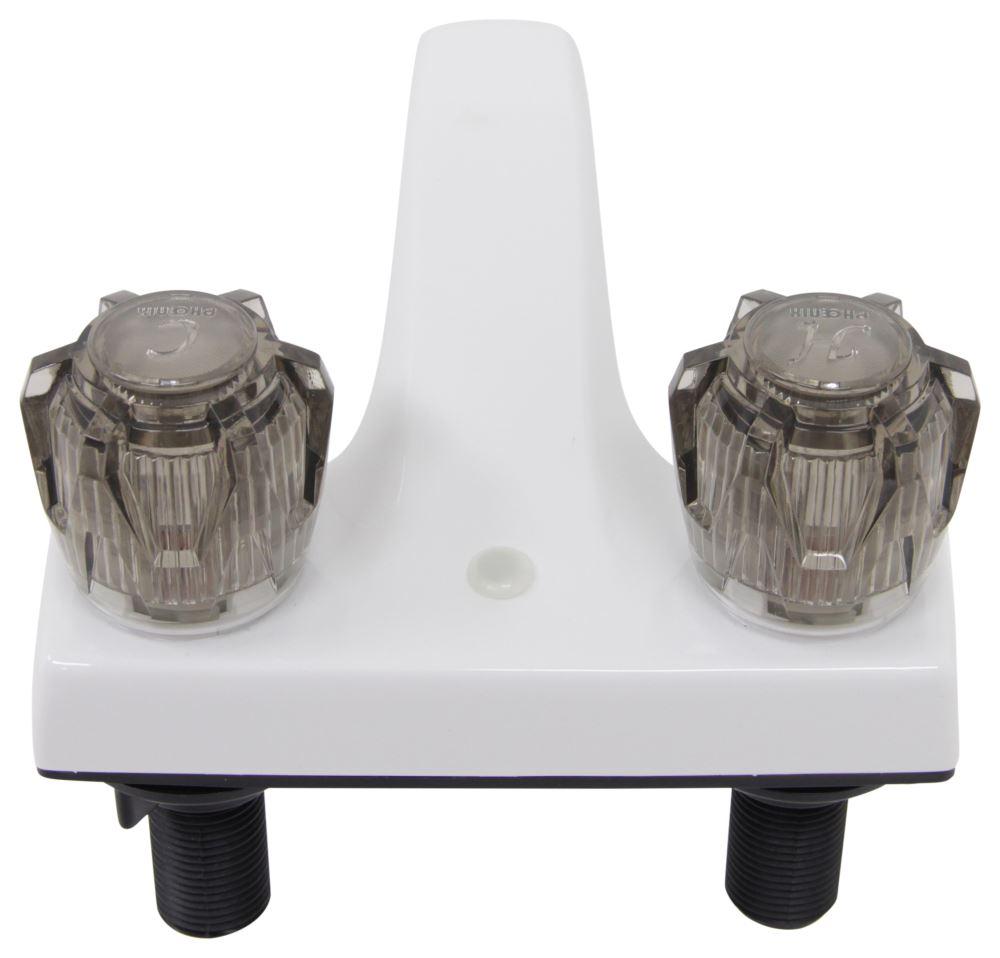 Phoenix faucets 4 dual handle rv bathroom faucet for Bathroom fixtures brushed nickel finish