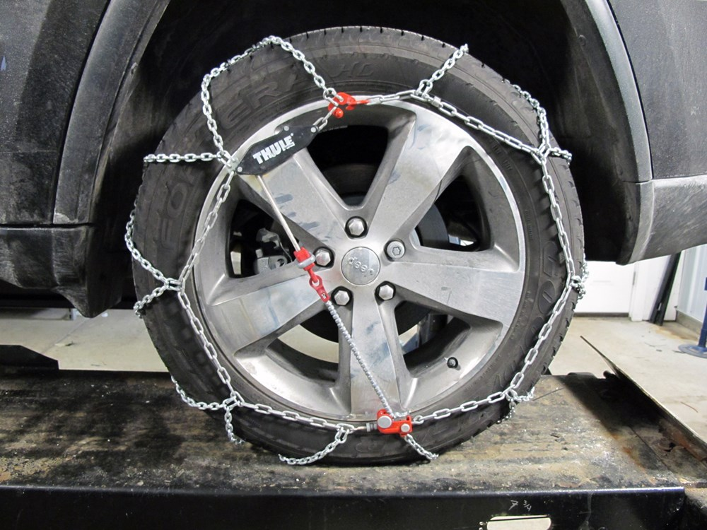 2015 jeep grand cherokee tire chains thule. Black Bedroom Furniture Sets. Home Design Ideas