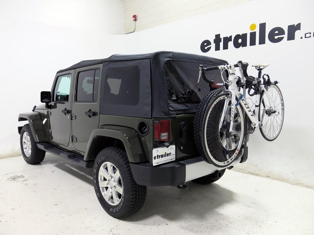 2016 jeep wrangler unlimited spare tire bike racks thule. Black Bedroom Furniture Sets. Home Design Ideas