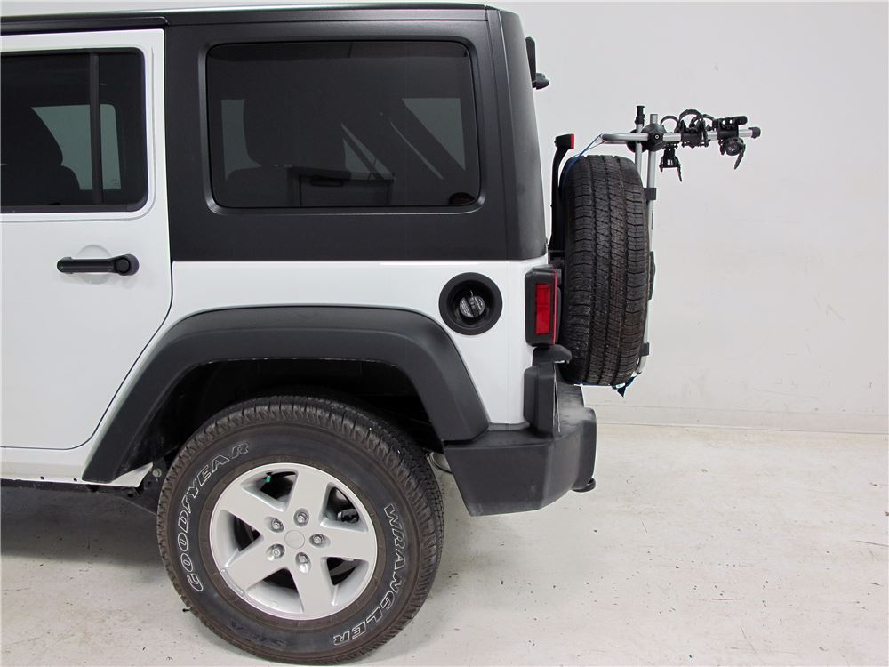 2016 jeep wrangler unlimited spare tire bike racks thule. Black Bedroom Furniture Sets. Home Design Ideas