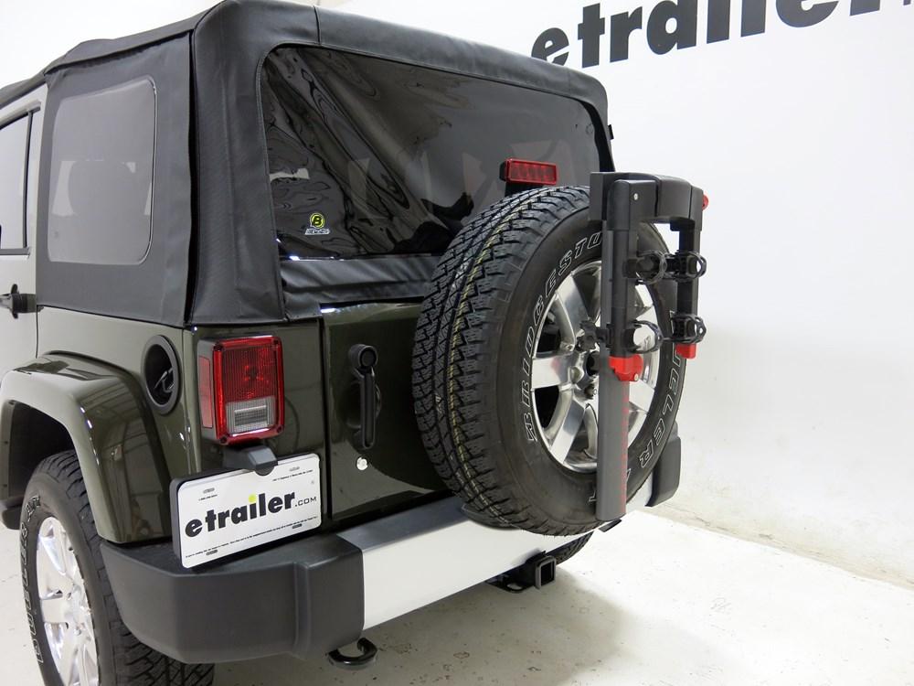 2011 jeep wrangler unlimited spare tire bike racks yakima. Black Bedroom Furniture Sets. Home Design Ideas