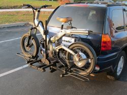 Hitch-mounted bicycle carrier for electric bikes in use