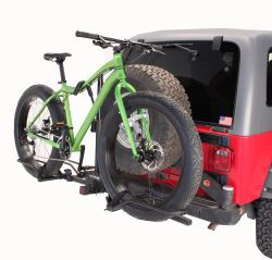 Hitch-mounted cicycle carrier for fatbikes in use