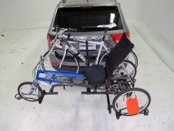 Hitch-mounted bicycle carrier for trikes in use