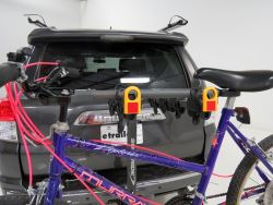 Bicycle with adapter bar mounted on trunk-mounted bicycle carrier