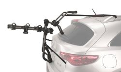 Trunk-mounted bicycle carrier mounted on SUV with a spoiler