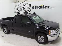 Roof mounted bicycle carrier on vehicle roof with bike installed