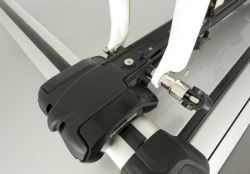 Closeup of skewer of fork-mount roof-mounted bicycle carrier with bicycle