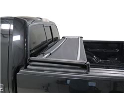 Soft, fold-up tonneau cover in folded up position installed on pickup truck