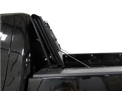Hard fold-up tonneau cover in folded up position installed on pickup truck