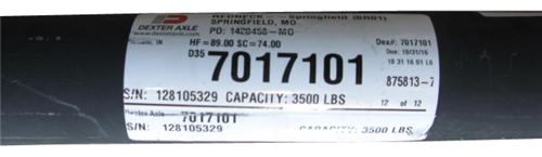 Trailer axle sticker that displays capacity