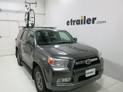 Malone roof-mounted bicycle carrier on sedan with bike