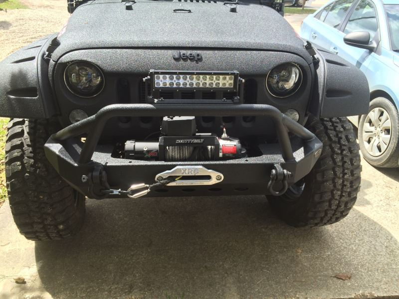 Flat Towing A 2015 Jeep Wrangler Unlimited Behind Motor