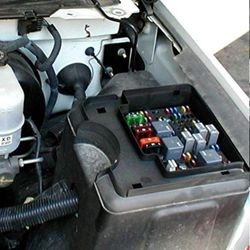 where is the fuse box in a chevy silverado com click to enlarge