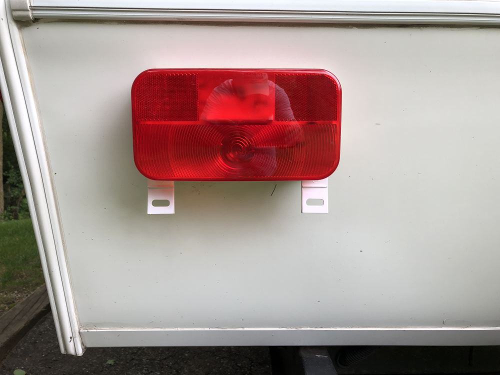 rv tail light - stop, tail, turn, license plate - rectangle - red lens -  driver side - white base optronics trailer lights rvst51