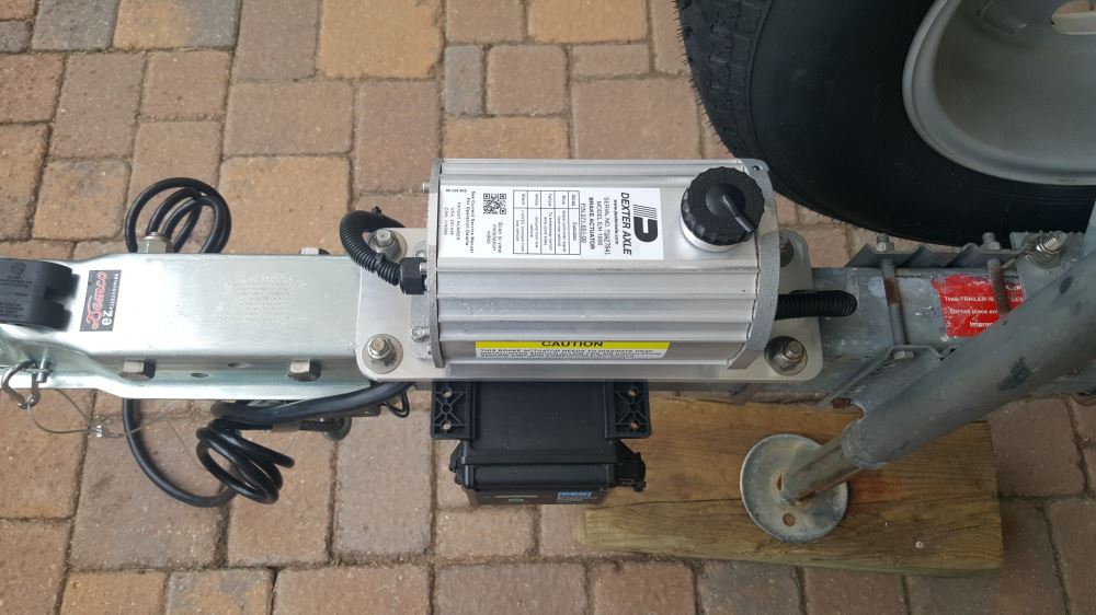 dexter dx series electric over hydraulic brake actuator for disc brakes -  1,600 psi dexter axle brake actuator k71-651
