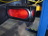 Optronics Trailer Tail Light - Stop, Turn, Tail - Submersible - Incandescent - Oval - Red Lens 6-1/2L x 2W Inch ST70RB