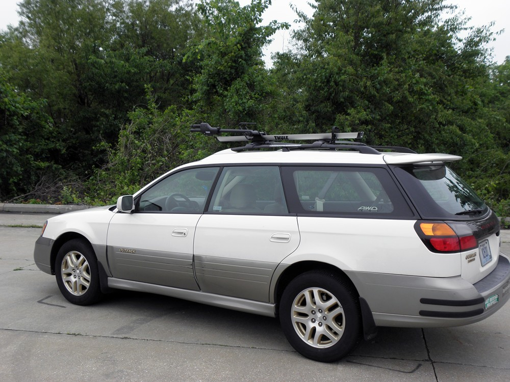 1999 subaru outback wagon thule sidearm wheel mount bike carrier roof mount. Black Bedroom Furniture Sets. Home Design Ideas