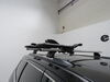 TH890000 - Clamp On - Standard Thule Watersport Carriers on 2014 Jeep Grand Cherokee