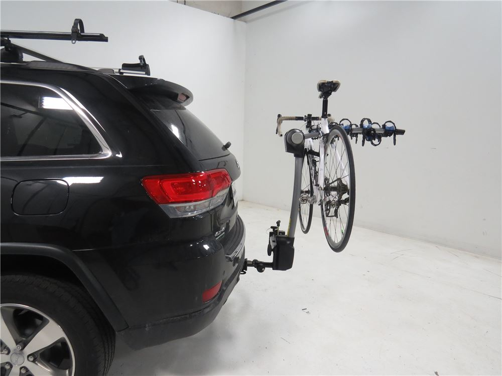 2014 jeep grand cherokee thule apex swing 4 bike rack for 2 hitches swinging. Black Bedroom Furniture Sets. Home Design Ideas