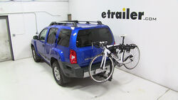 Thule hitch-mounted bicycle carrier installed on Nissan Xterra with bike loaded
