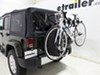 TH963PRO - Hanging Rack Thule Spare Tire Bike Racks on 2015 Jeep Wrangler Unlimited