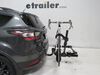 "Kuat Transfer 2 Bike Platform Rack - 1-1/4"" and 2"" Hitches - Wheel Mount - Tilting - Black Carbon Fiber Bikes TS02B on 2017 Ford Escape"