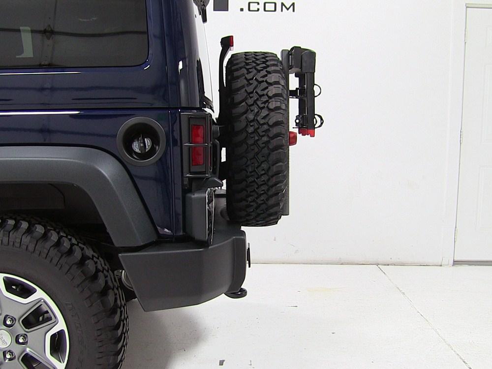 2013 jeep wrangler unlimited yakima sparetime 2 bike. Black Bedroom Furniture Sets. Home Design Ideas