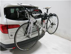 Yakima trunk-mounted bicycle carrier on SUV with bike loaded